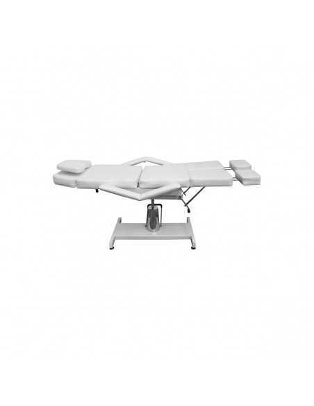 Hydraulically adjustable white tattoo table
